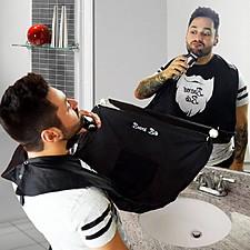 Babero para recoger pelos al recortarse la barba