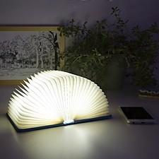 Lámpara con forma de libro que se ilumina al abrirse