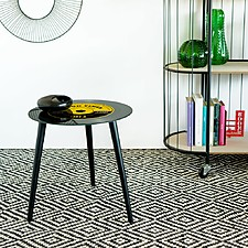 Mesa auxiliar con forma de disco de vinilo
