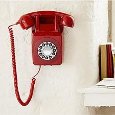 Teléfono retro estilo años setenta de pared