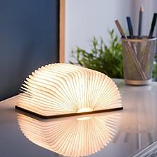 Lámpara libro que se ilumina al abrirse