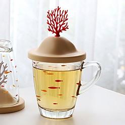 Taza de cristal con tapa decorada con un coral