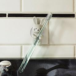 Soporte para cepillo de dientes en forma de conejito o perrito