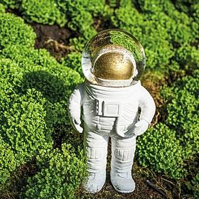 Bola de nieve con forma de astronauta