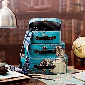 Set de tres maletas de almacenaje con mapamundi retro