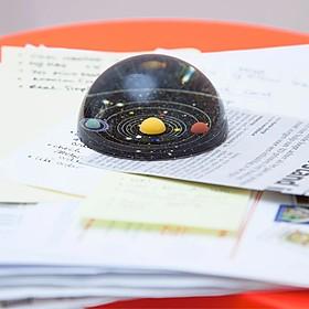 Pisapapeles con el sistema solar