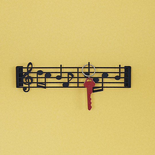 Colgador de llaves con forma de partitura