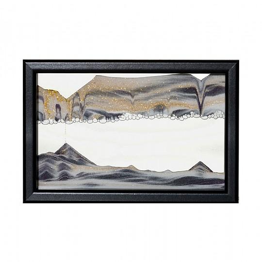 Y con el marco negro con la arena negra, blanca y dorada