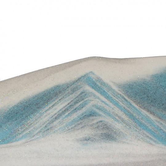 La arena crea composiciones diferentes cada vez que lo giras