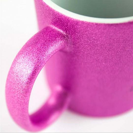 Fabricada en cerámica con acabado de purpurina rosa