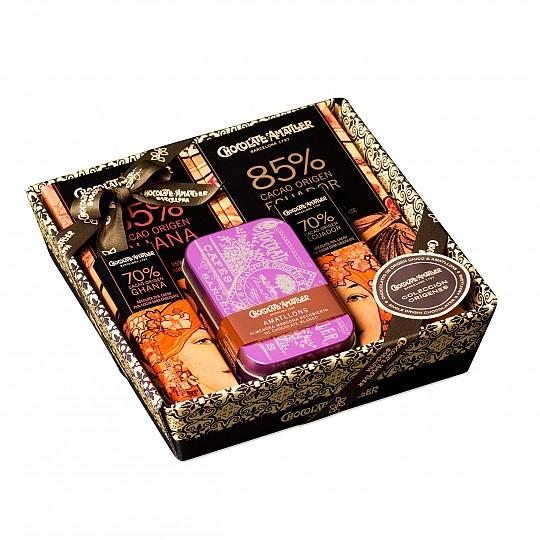 Una cesta de chocolates perfecta para regalar, envuelta en un papel transparente con un lazo