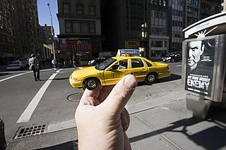 A toy yellow cab on the streets of Manhattan