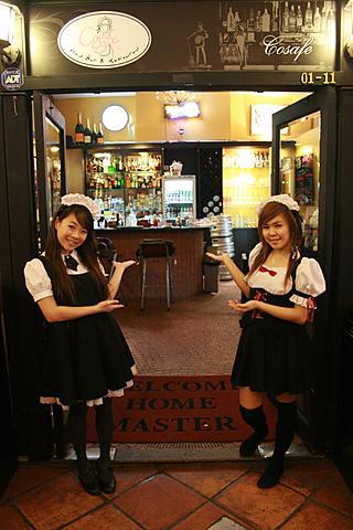 Two waitresses outside a Maid Café